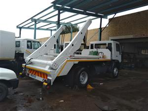 2010 model MAN single diff skip truck available now