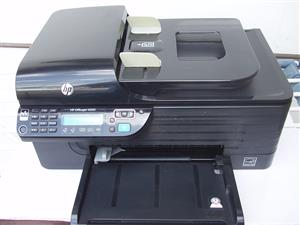HP 4500  Office jet Printer - needs cartridges - in original box with manuals and cables