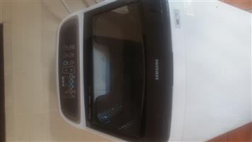 Whirlpool side by side 246L silver fridge freezer and 13kg Samsung washing machine for sale