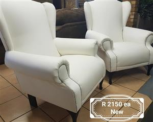 2 White studded 1 seater couches for sale