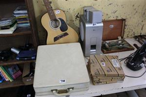 Guitar,amp and white suitcase