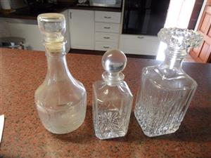 3 GLASS WHISKEY DECANTERS WITH LIDS