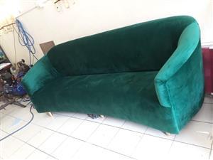 New green couch in emerald velvet finish.