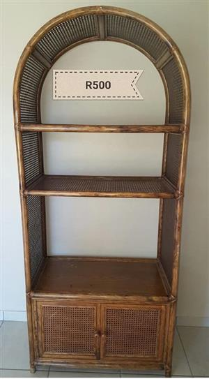 Arched cane shelf cabinet