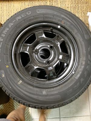 Four New 155/80 R 13 tyres with steel rims and new Renault Kwid Hub caps