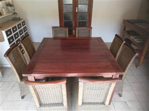 Very nice wood and wicker dining room table with 8 chairs