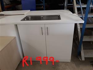White kitchen cabinet with sink