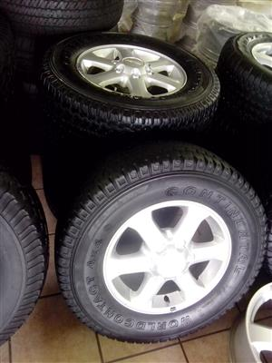 Isuzu 16 inch rims with used 245/70/16 Continental Cross Contact R6000 x4 set.