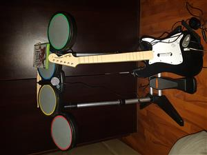 Guitar hero set with drums and microphone