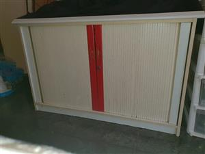Red and white sliding door cabinet