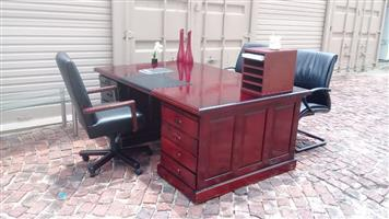 Executive desk with leather in lay and chairs