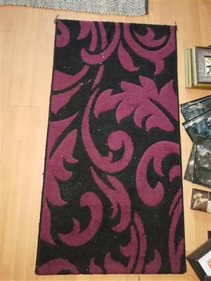 Black and purple colored rug for sale