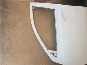 Chevrolet van left passenger door with door handle.