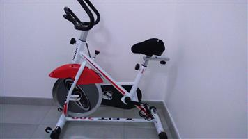 Spinning bike and exercise stepper for sale.