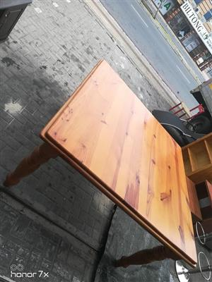 Pine seater dining room table for sale.