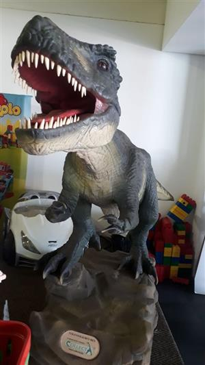 Life size T-rex dinosaur that moves and makes sounds.