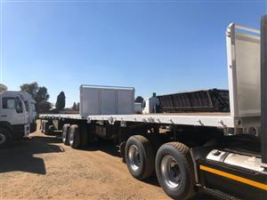 Super link flat deck trailer