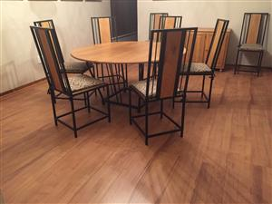 Oak & cast iron dining room suite, with eight chairs & 3 door side table