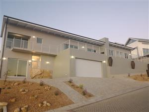 brand new 4 bedroom house, 4 car tandem garage, splash pool, low maintenance, excellent views
