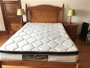 Double bed in pine with mattress