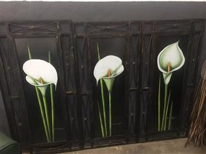 Stunning painted artworks inside a wrought iron frame with glass