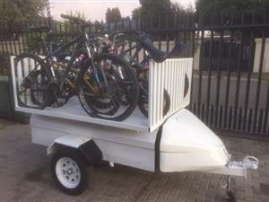 glider trailer with rack to carry bikes, without moving wheels, price can be discounted if the rack is excluded