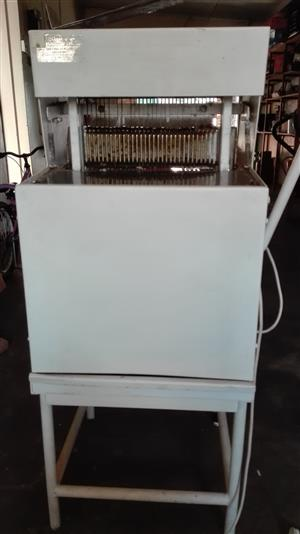 Kuhn - Model B bread slicer machine | Junk Mail