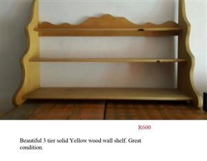 Yellow wood wall shelf