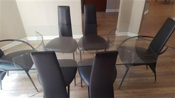 Upmarket 6 Seater All Glass Table and high back chairs as new at R6500 o.n.c.o