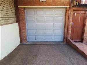 Meranti Garage Door with motor