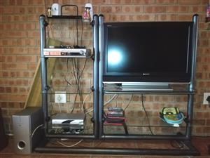 Tv stand with sony tv and lg seround sound.