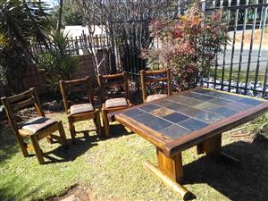 """Urgent sale:""""leiklip"""" dining  room log  table and four chairs for sale"""
