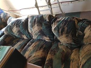 Green colored 3 seater couch