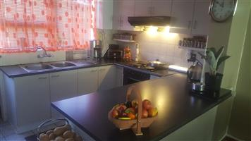 STELLENRIDGE - 3 BEDROOM TOWNHOUSE WITH BRAAI ROOM - DOUBLE GARAGE AND PRIVATE BACKYARD