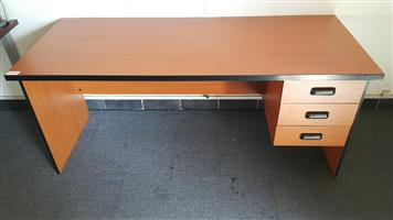 Cherry finish desk with drawers