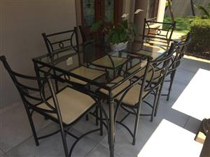 PATIO SET. STEEL/ALUMINIUM FRAME TABLE WITH 10mm SAFETY GLASS TOP & 6 x RATTAN CHAIRS