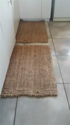 2 Light brown rugs
