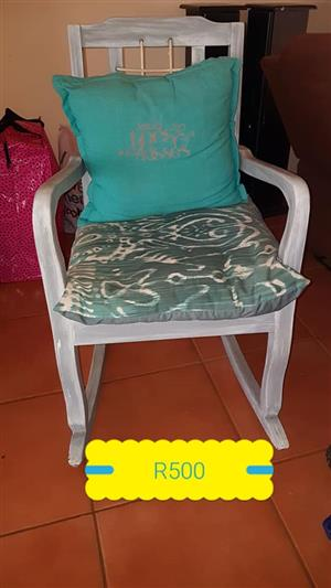 Wooden chair with pillows