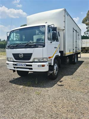 2015 Nissan UD80 Closed Body truck with a tail lift for sale