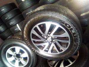 18 inch Nissan Navara/ Pathfinder mags with used tyres for R5500.