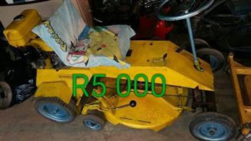 Yellow petrol ride on lawnmower