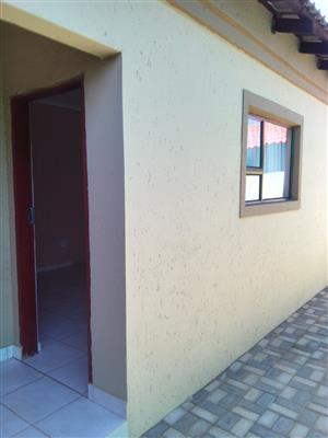 ONE Very neat and spacious room and ONE massive garage to rent separately