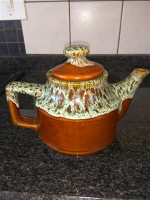 Rusted brown and white teapot
