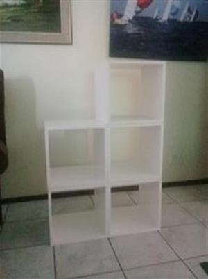 A 5 cubes modular style bookshelf .
