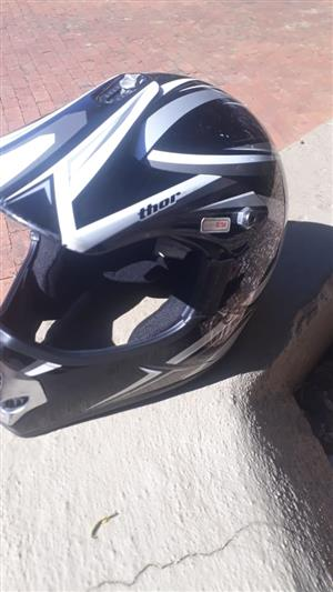 Nearly new Thor motorbike helmet.  Size S / M.  Black, white, silver.  Very good condition.