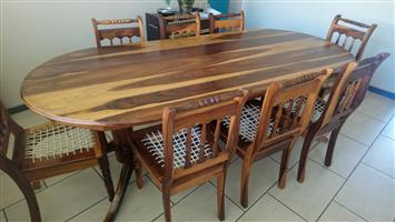 BARGAIN Solid Kiaat Dining room table and 8 Riempie chairs plus Hostess Trolley/Food Warmer