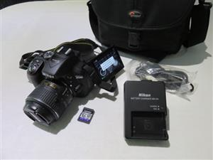 Nikon D5300 DSLR 24.2 MP with 18-55mm AF-P lens 32gb SD and bag