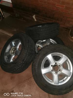 Isuzu original rims with tyres