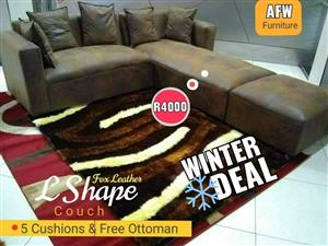 Brown material L shape corner couch