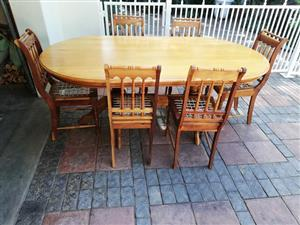 6 seater oval dining room suite yellow /black wood